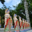 Buddha statues in a line — Stock Photo