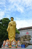 Buddha statues white blue sky — Stock Photo