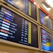 Departure board in airport — Stockfoto