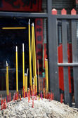 Joss sticks in front of temple — Stock Photo