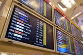 Departure board in airport — Stock Photo