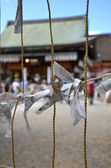 Paper fortune charms hanged on a line in a temple — 图库照片