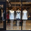 Boutique display window with mannequins in fashionable dresses — Stock Photo