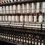 Bobbin thread cones on a warping machine in a textile mill — Stock Photo