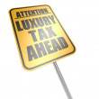 Luxury tax ahead road sign — Stock Photo