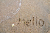 Hello word written on the sandy beach — Stockfoto