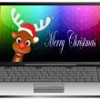 Stock Photo: Laptop with Reindeer with santhat wishing Merry Christmas