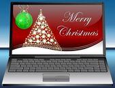 Ordenador portátil con tarjeta de navidad feliz — Foto de Stock