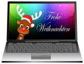 Laptop with Reindeer with santa hat wishing Merry Christmas — Stock Photo