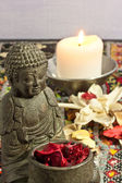 Buddha and candles — Stock Photo