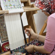 Stock Photo: Wooden loom with weaver
