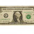 Stock Photo: Bent one dollar bill