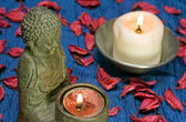 Buddha and candle — Stock Photo