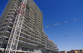 Scaffolding on a construction site of a new building — Stock Photo