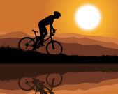 Cyclist on a mountain bike riding along a mountain lake — Stock Vector