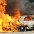 Burning police car. - Stock Photo