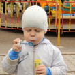 Park. Boy inflates soap bubbles — Stock Video