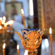 Russian Orthodox Church. Burning candles on a candlestick - Stock fotografie