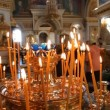 Russian Orthodox Church. Burning candles on a candlestick — Stock Video