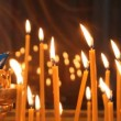 Russian Orthodox Church. Burning candles on a candlestick - Stock Photo