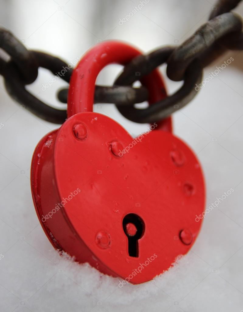 Red closed lock in the form of heart on the background of snow  Stock Photo #19173207