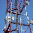 Telecommunication tower with antennas of cellular communication in the sky - Stockfoto