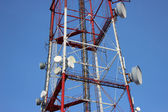 Telecommunication tower with antennas of cellular communication in the sky — Stock Photo