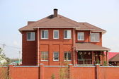 Cottage country house of bricks — Stock Photo