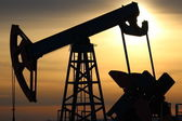 Oil production. Oil pumps at sunset — Stock Photo