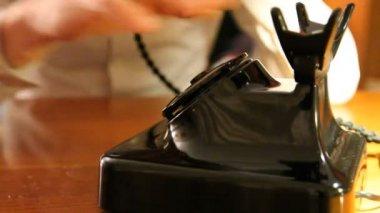 Vintage black telephone. Man dials — Stock Video