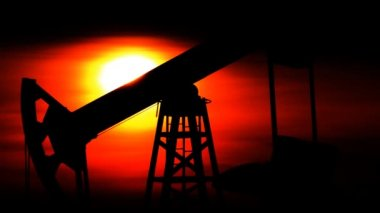 Oil production. Oil pumps at sunset — Vidéo