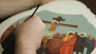 Iconographer painting of Christian icon with brush — Stock Video