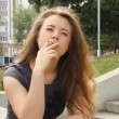 A young girl with a cigarette — Stock Video