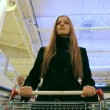 Stock Video: A girl in a supermarket