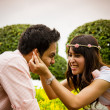 Stock Photo: Couple tease in garden2