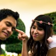 Couple tease in garden1 — Stock Photo #41257077