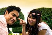 Couple tease in the garden1 — Stock Photo