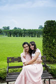 Lovely couple sit in the garden1 — Stock Photo