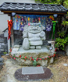 Small shrine with little giant stone — Stok fotoğraf