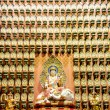 Guan Yin with thousand statues1 — Stock Photo