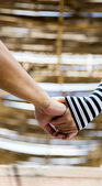 Hold hands of couple — Stock Photo
