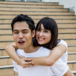 Stock Photo: Lovely couple piggy back ride on stairs6
