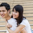 Lovely couple piggy back ride on stairs3 — Stock Photo #41489349