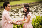 Lovely couple hold the hands in the garden1 — Stock Photo