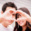 Lovely couple with love hand sign2 — Stock Photo