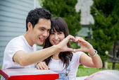 Lovely couple with love hand sign3 — Stock Photo