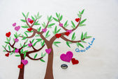 Trees of heart on white wall — Stock Photo