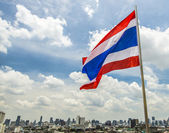 Thailand flag with city scene — Stock Photo