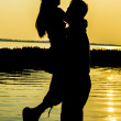 Foto Stock: Lovely Couple on sunset silhouette  scene3