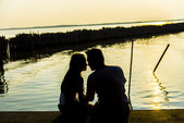 Lovely Couple sit and look together with romance scene — Stock Photo